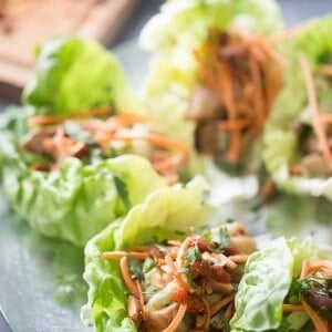 Soy ginger chicken, tender mushrooms, cool cucumbers, crisp carrots and spicy almonds are tucked inside these chicken lettuce wraps. The perfect hand held meal! LemonsForLulu.com