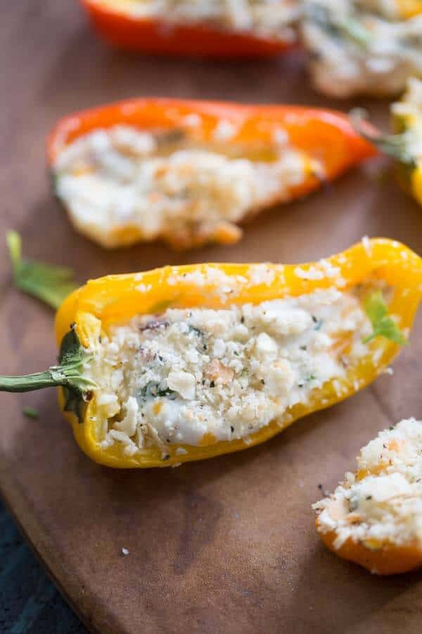 Mini stuffed peppers are grilled just until the two kinds of cheese begin to bubble. Each bite features fresh kale and salty bacon for maximum flavor! lemonsforlulu.com #ChoppedAtHome #ad