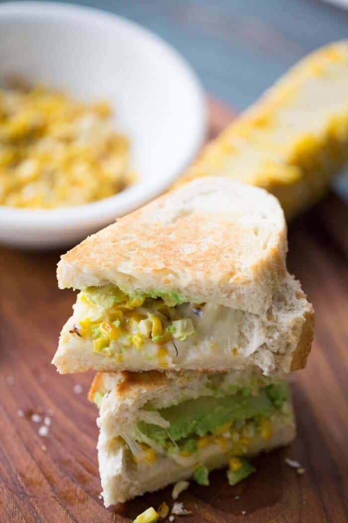 This grilled avocado and corn sandwich recipe captures the essence of summer! Fresh veggies and creamy cheese make this sandwich irresistible! lemonsforlulu.com