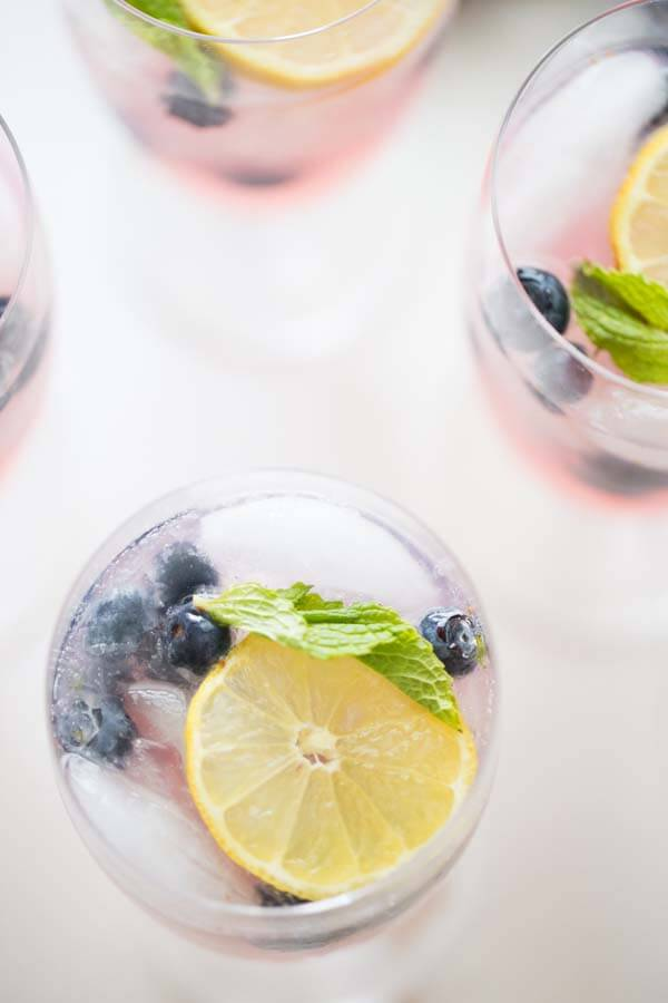 Blueberries and mint add freshness to this easy vodka lemonade recipe! Tart lemonade and blueberry vodka make this drink a real hit! lemonsforlulu.com