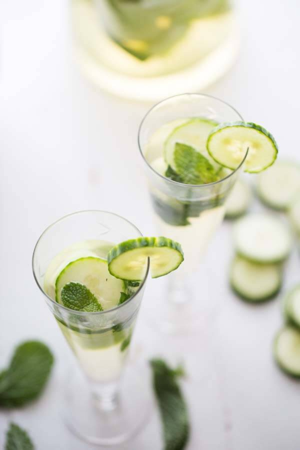 Cucumbers are not just for savory foods! This simple white sangria features lots of fresh cucumbers, cool mint and sweet melon! The perfect cocktail to keep you refreshed! lemonsforlulu.com