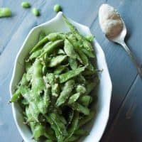 Edamame coated in olive oil, lots of garlic and Parmesan cheese! lemonsforlulu.com