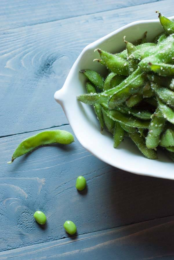 Edamame pods tossed with a little olive oil, garlic and Parmesan cheese. Nature's finger foods! lemonsforlulu.com