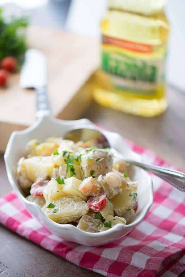 This po boy potato salad is truly an easy side dish that will complete any bbq! lemonsforlulu.com #MazolaCornOil