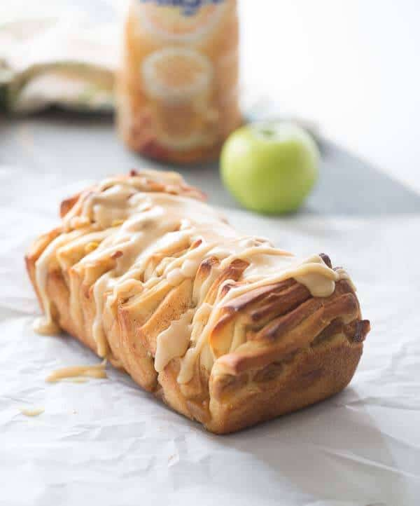 Caramel apple pull apart bread made with sweet apples, a tender cinnamon spiced dough and a silky caramel glaze! lemonsforlulu.com #CreateDelight #IDelight