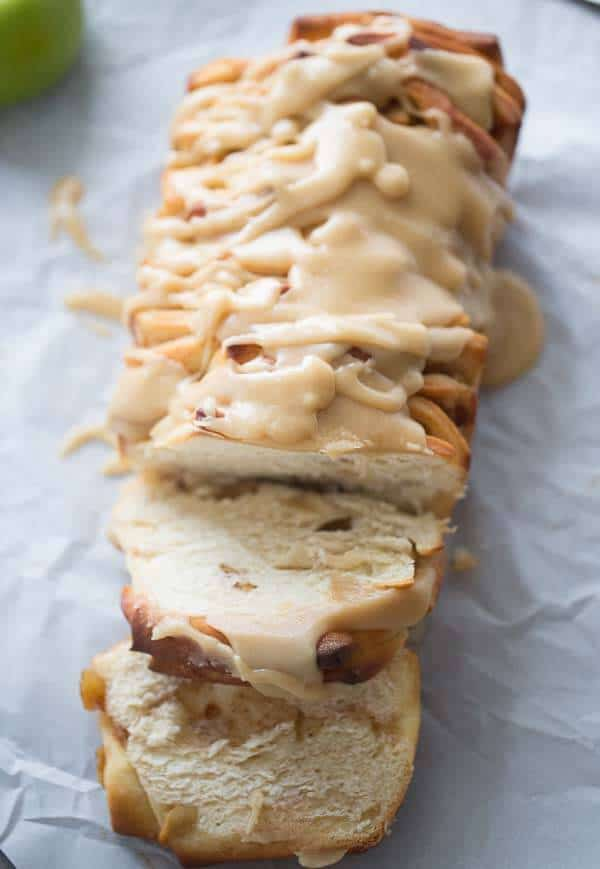 Apple cinnamon pull apart bread with a delicious caramel glaze! lemonsforlulu.com #CreateDelight #IDelight