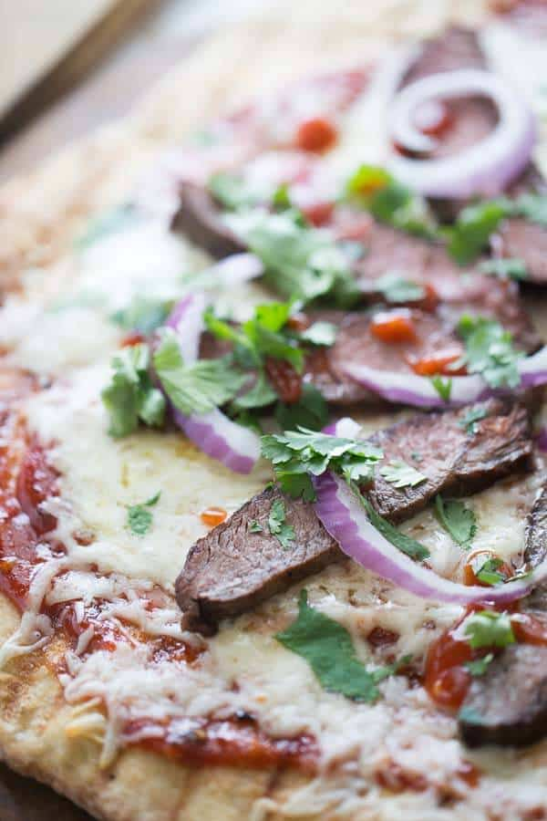 BBQ steak pizza that is made right on the grill! This pizza is smokym, sweet, spicy and delicious! lemonsforlulu.com