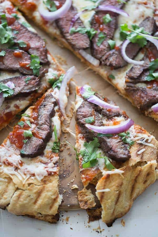 This pizza starts with an easy pizza crust that is made with your favorite beer. The sweet yeasty dough is grilled and covered in a chili garlic bbq sauce, flank steak and gouda cheese. This takes pizza to a whole new level. lemonsforlulu.com