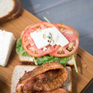 This gourmet BLT recipe features bbq seasoned bacon and thickly sliced blue cheese! lemonsforlulu.com
