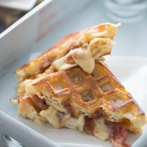 A savory waffle sandwich recipe with apple butter, bacon and fontina cheese! lemonsforlulu.com