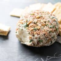 This easy cheese ball is crazy good! Roasted garlic and three kinds of cheese make this creamy appetizer positively addicting! lemonsforlulu.com