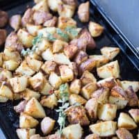 Oven-roasted-potatoes-that-are-simply-tossed-with-garlic-hummus. lemonsforlulu.com