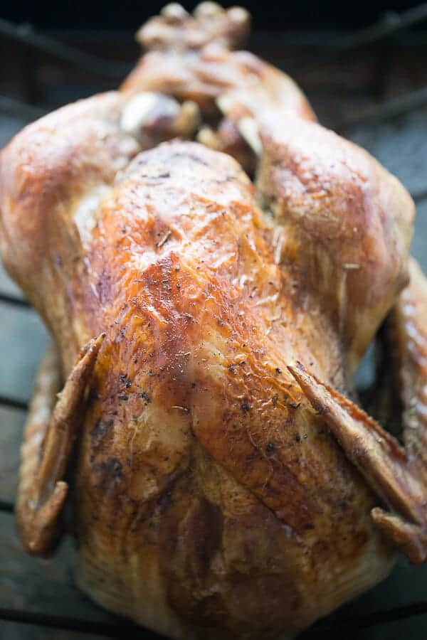 Slow roast turkey recipe that delivers flavorful and moist turkey every time! lemonsforlulu.com