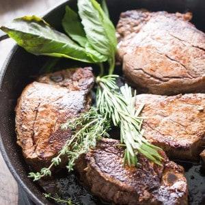 Beef tenderloin steak recipe served with thick portobello slices and fresh herb butter! lemonsforlulu.com