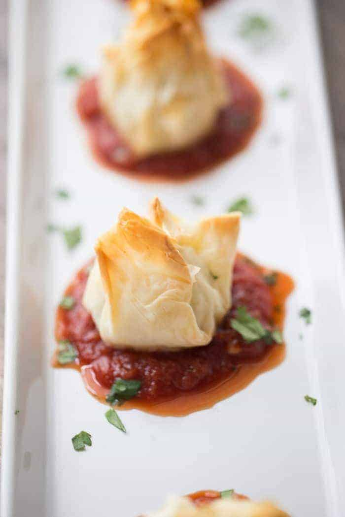 Chicken Parmesan meatballs wrapped in flaky sheets of fillo dough! lemonsforlulu.com