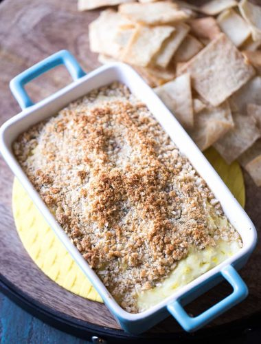 Dill pickle dip with cream cheese, Parmesan cheese and lots of dill pickles! The crunchy topping makes this easy dip taste just like a fried pickle! lemonsforlulu.com