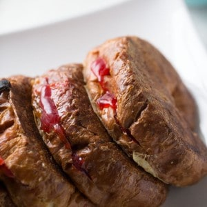 Strawberry stuffed croissant French toast drizzled with a little sweetned condensed milk; Cuban style!