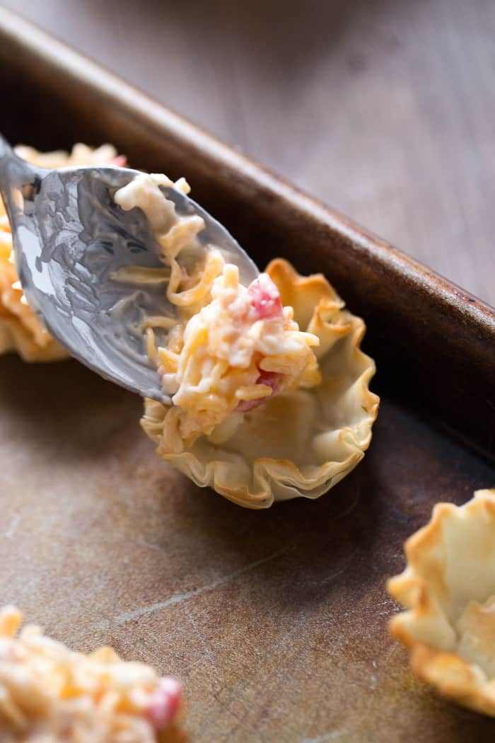 Flaky little fillo cups filled with a pimento cheese spread then baked; an appetizer for any occasion!
