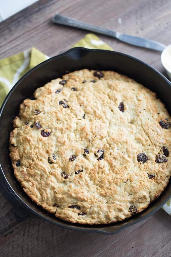 Irish soda bread sweetened subtly with pure maple syrup and dried cherries. This rustic style bread is made quickly and baked in an iron skillet!
