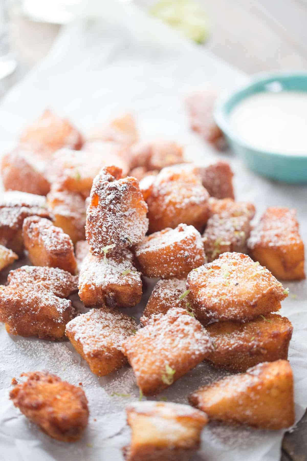 Fried tequila shots are sipped bites of angel good cake that have been dipped in tequila! I served these with a very simple lime dipping sauce; a little margarita taste with every bite!