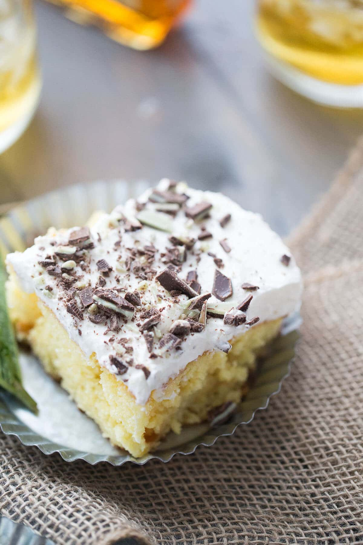Whether mint julep cocktails are your thing or not, I promise you will love this decadent poke cake dessert recipe!