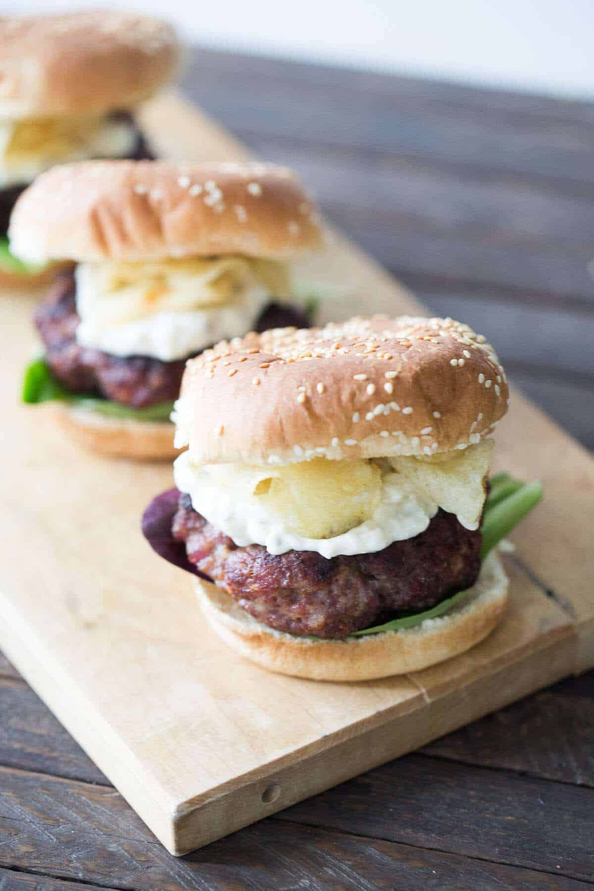 Thick and meaty black and blue burgers have Cajun seasoning, a blue cheese remoulade sauce and crunchy kettle chips!