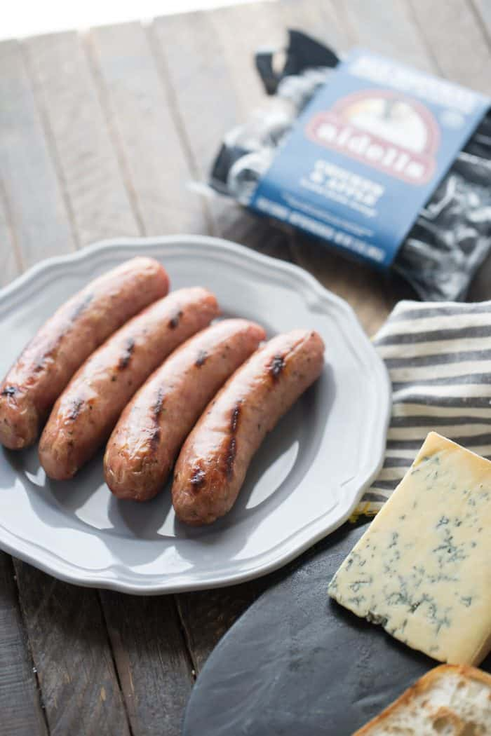 Chicken apple sausages are combined with arugula, tomatoes and Stilton cheese. Serve this easy