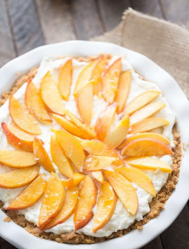 This fresh peach pie is easy, creamy and delicious! This crown pleasing pie has a shortbread crust, a fluffy mascarpone filling and lots of fresh peaches on top!