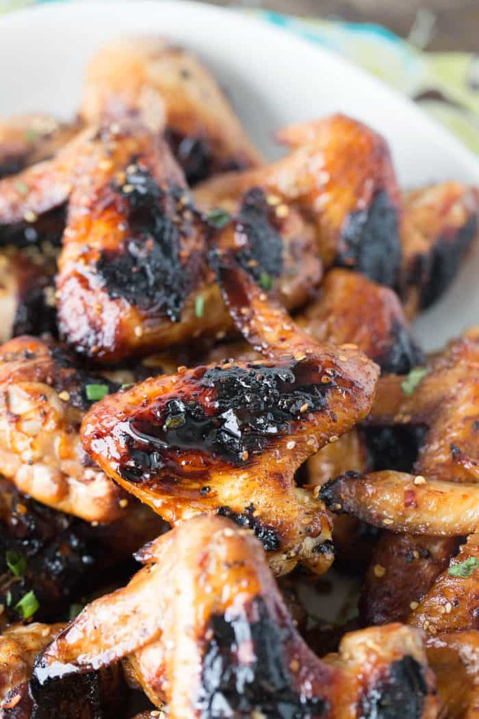 A tangy sesame ginger sauce is brushed over chicken legs and wings  then grilled up golden and crisp.  Grilled chicken tastes so good!