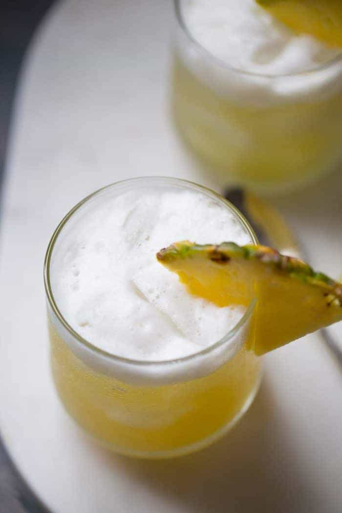 Pineapple Bourbon Punch - Nutty hazelnut flavor and pineapple are infused into bourbon to make this delicious cocktail recipe! | lemonsforlulu.com