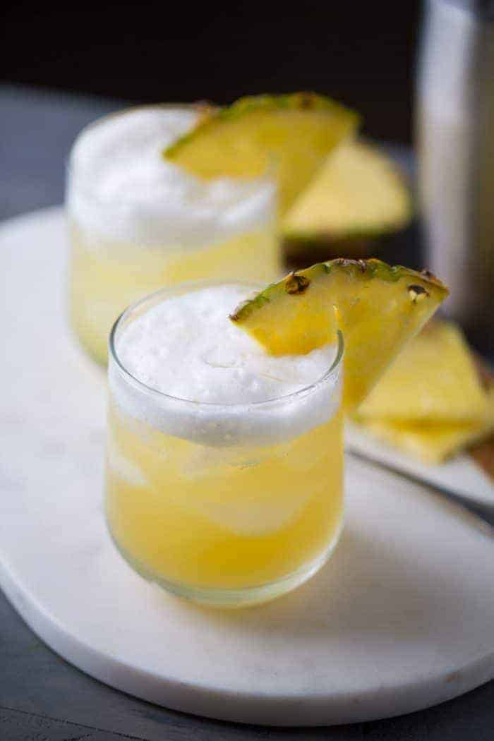 Pineapple Bourbon Punch - Bourbon is infused with hazelnut liqueur and sweet pineapple juice. The combination of flavors is tropical and earthy all at once!   lemonsforlulu.com