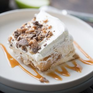 "This eclair cake is like apple pie but better! Graham crackers are the ""cake"" layers that are held in place with apple pie filling and apple spiced pudding. Toffee bits crown the top!Fold in 12 oz whipped topping into pudding mixture."