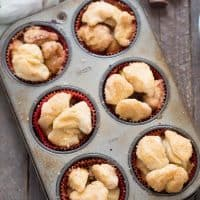 Monkey bread muffins are made with biscuits and stuffed with a sweet, apple filling!