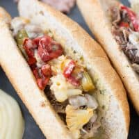 Nothing beats a good cheesesteak sandwich! This Italian version has pickled vegetables, roasted red peppers, provolone and a hummus garlic herb spread!