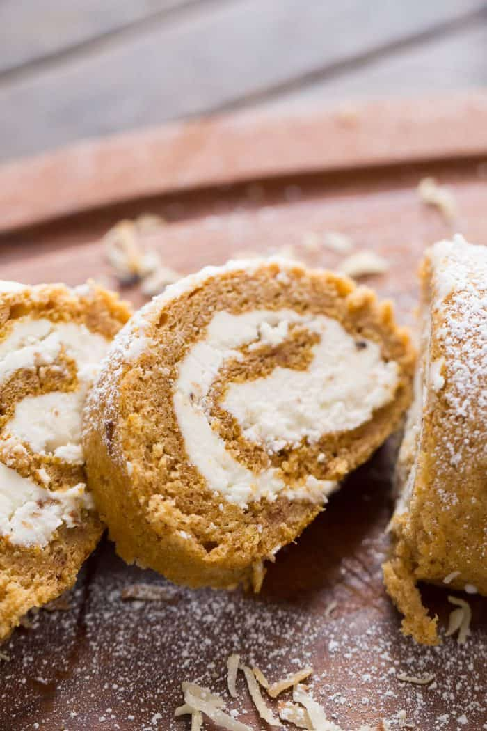 This pumpkin roll has a unique flavor combination. Toasted coconut buttercream is swirled in the center!