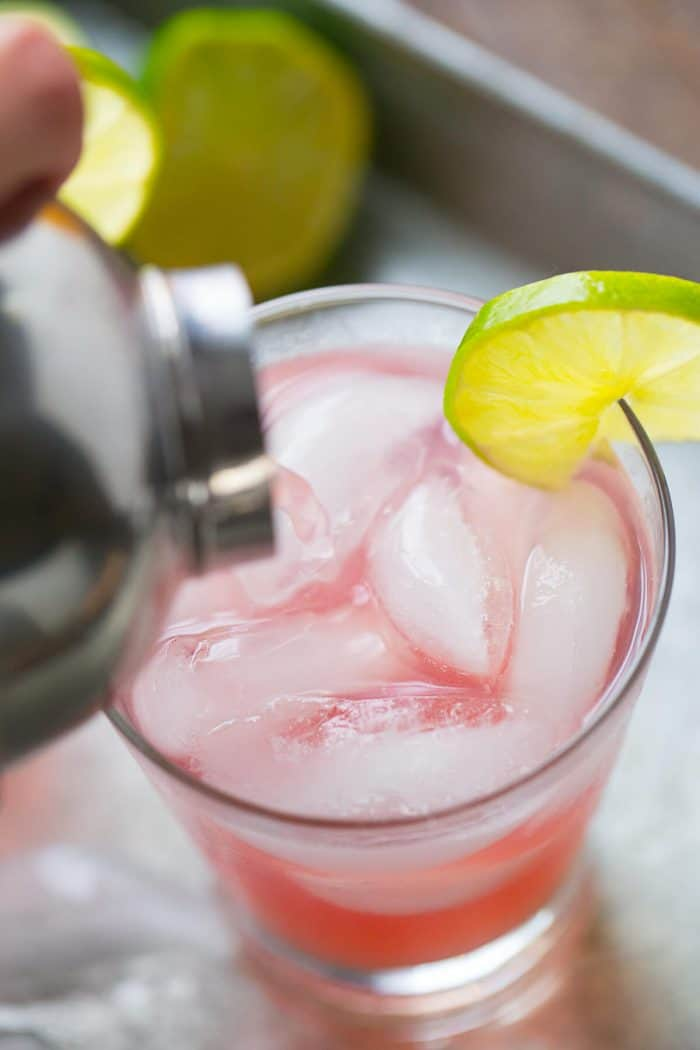 Cranberry juice and tangerine lemonade make this margarita on the beach cocktail festive and delicious!