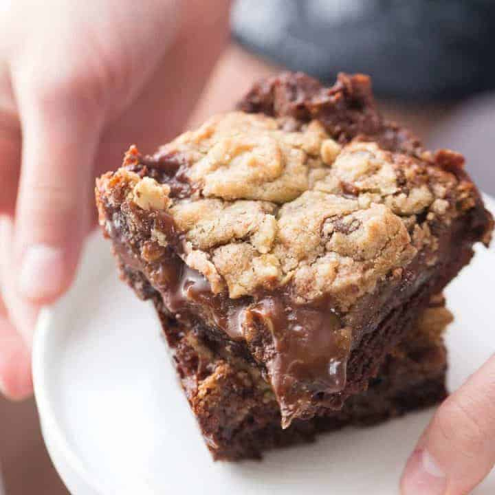 These Brookie bars have chocolate brownie base, a chocolate chip cookie top and a smooth chocolate caramel layer in the center!