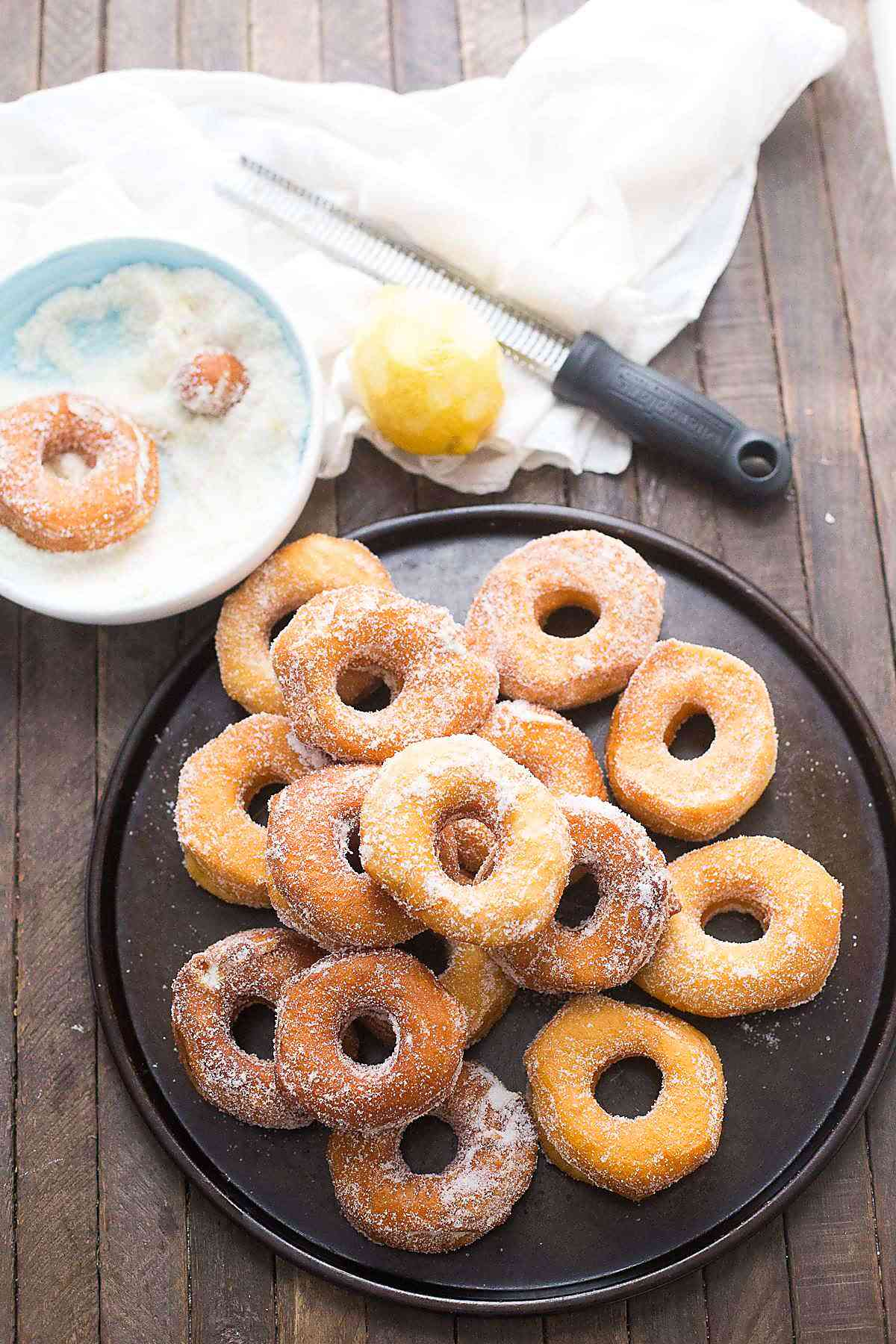 Biscuit donuts are lightly fried then coated in a simple lemon sugar mixture!