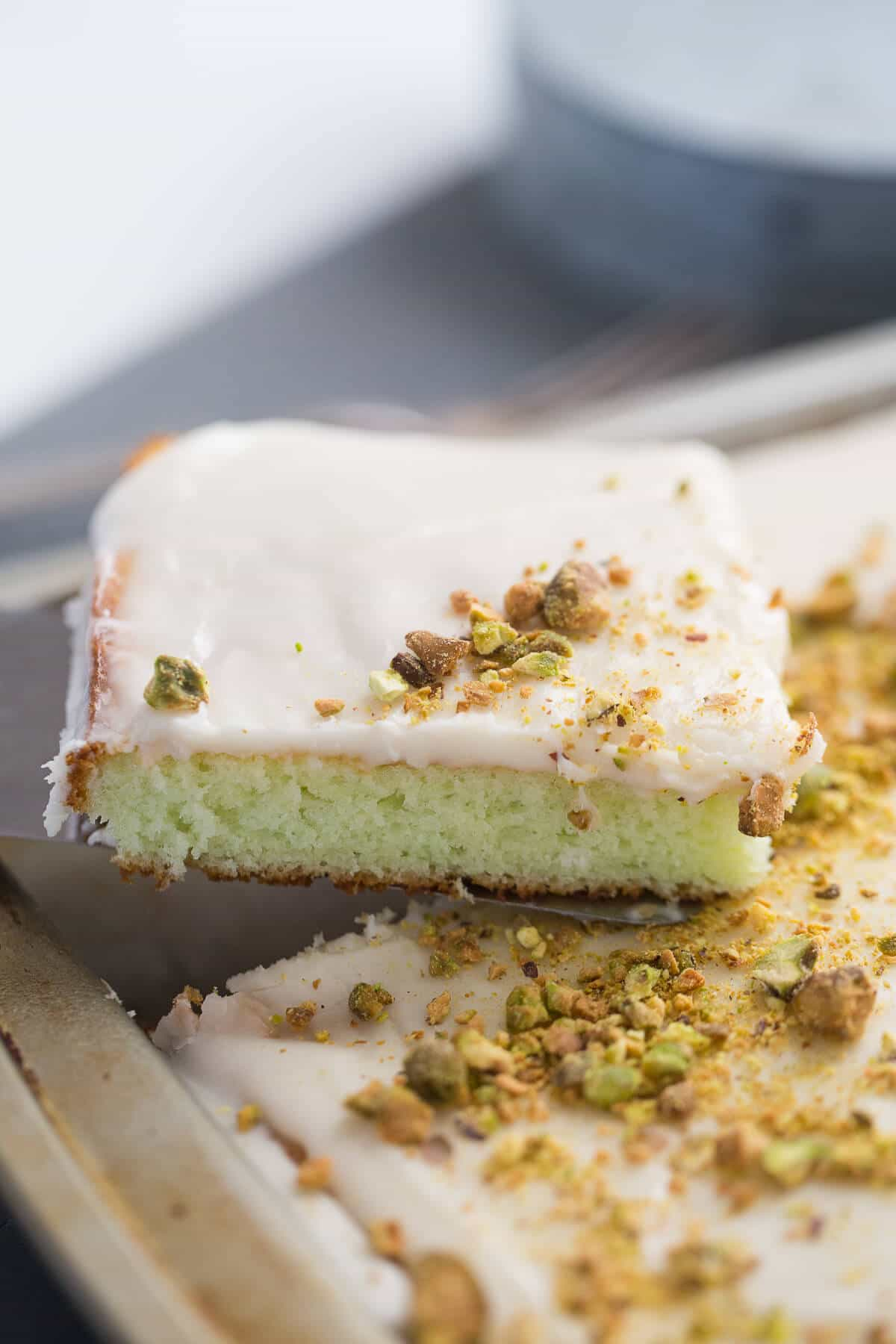You are going to love this pistachio pudding cake. The simple vanilla frosting is the perfect compliment!
