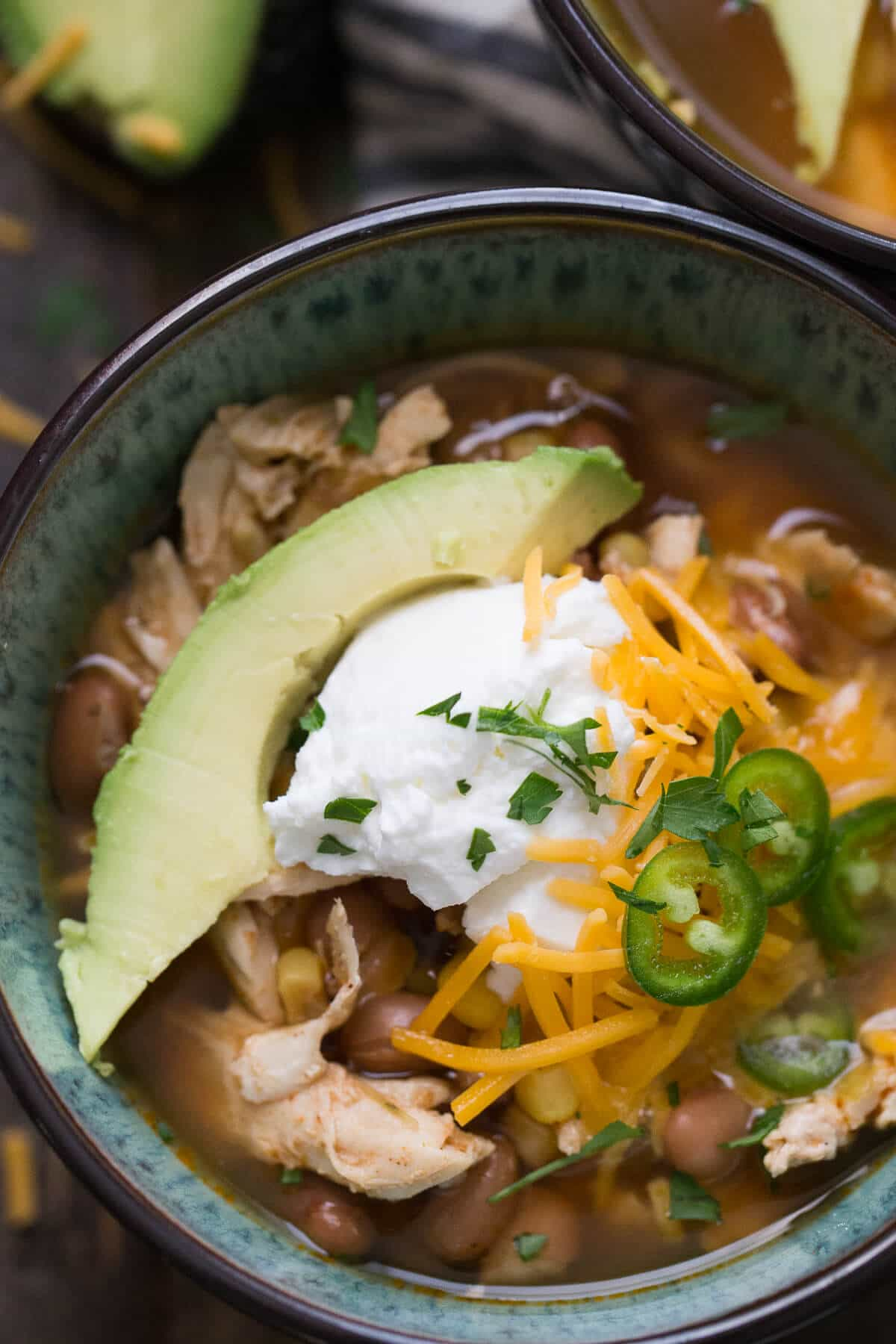 You are going to love this slow cooker chicken chili! It is so easy and so satisfying!