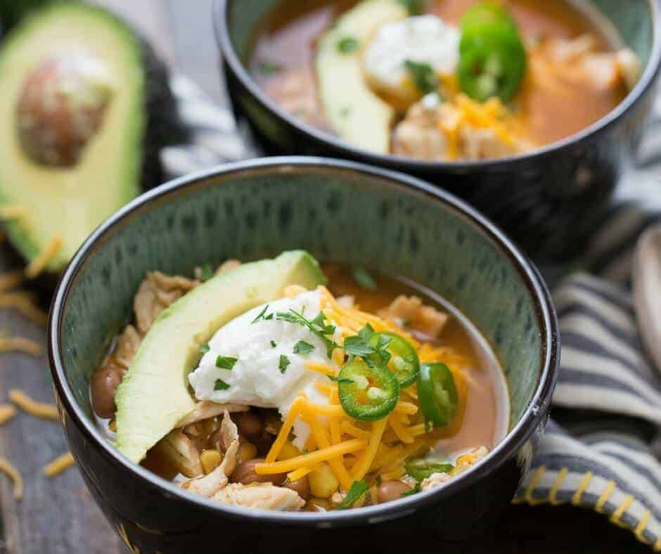 This slow cooker chicken chili is so easy! Let the slow cooker do all the work! This is a family pleasing recipe!