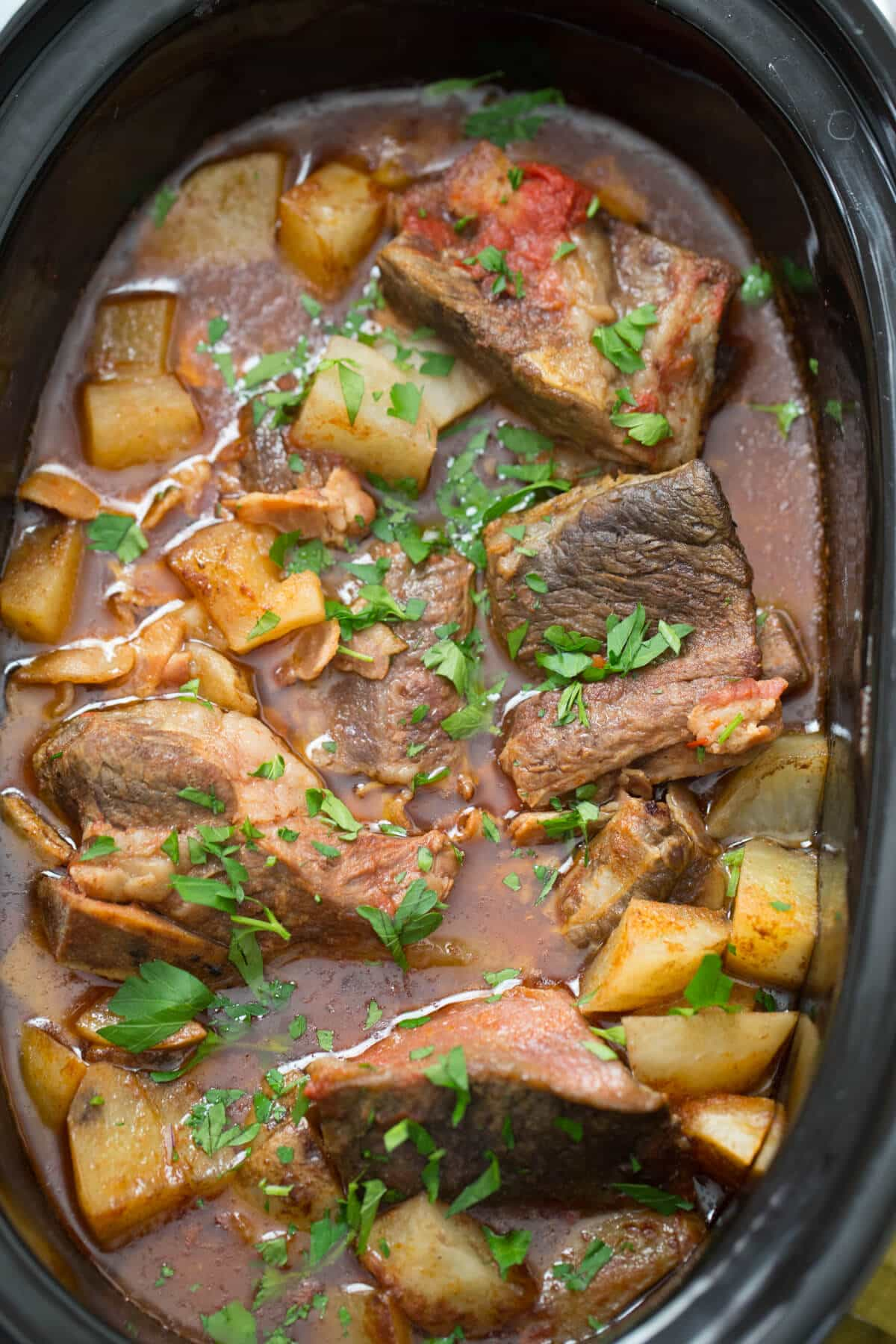 Slow cooker short ribs are resting in Guinness infused broth!  How can you say no?