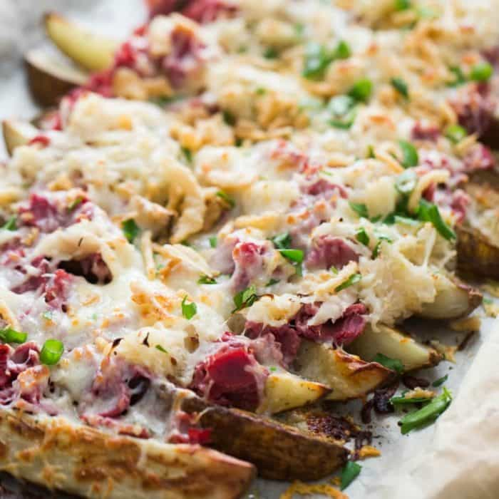 This loaded potatoes recipe is so good! Classic reuben ingredients are a piled high on top of crispy potato wedges!