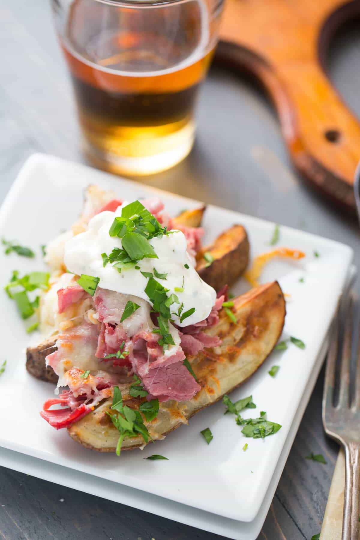 Loaded potatoes recipe the is topped with corned beef, kraut, cheeses and crispy onions! Absolutely delicious!