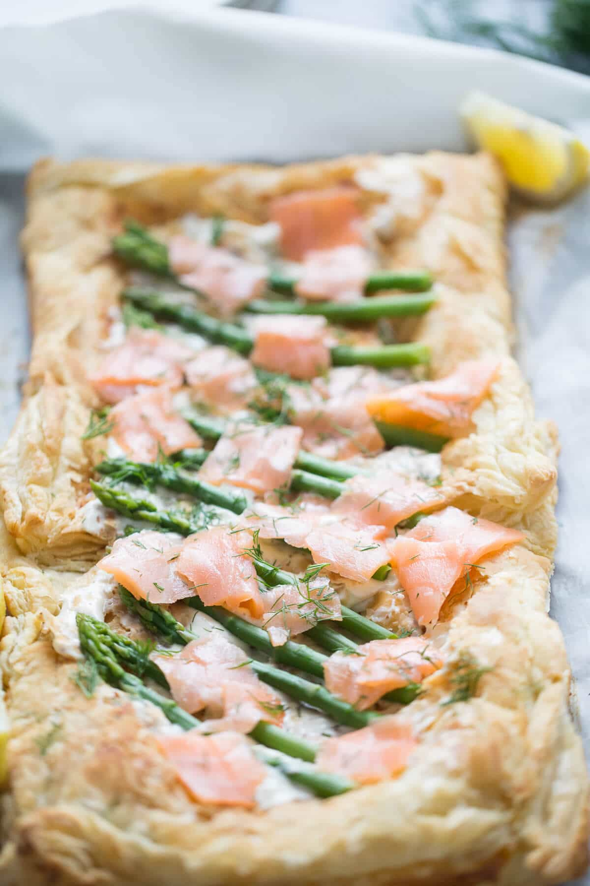 This recipe for asparagus and smoked salmon tart is a simple and elegant addition to any table!