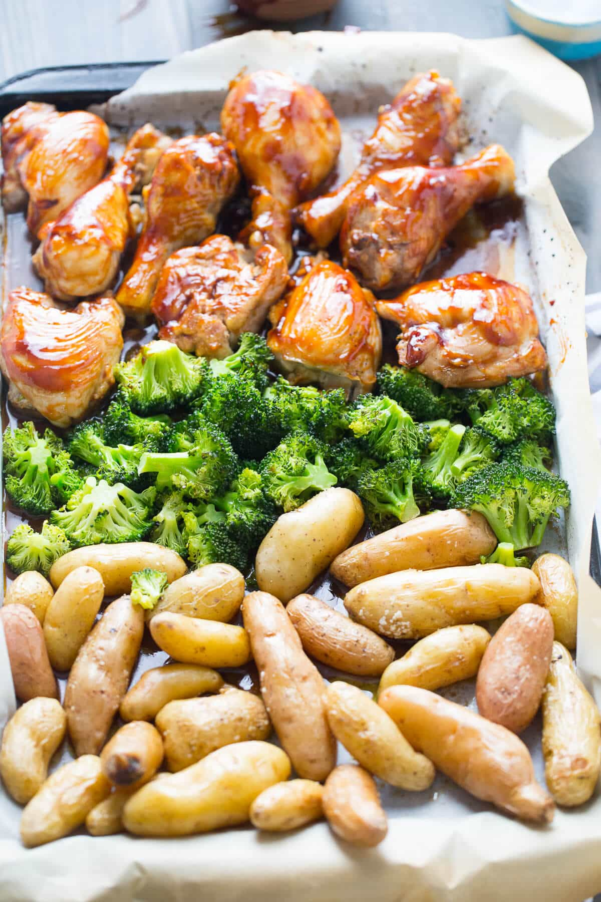This sheet pan dinner is fantastic! This bourbon chicken recipe is baked with potatoes and broccoli then basted with a bourbon glaze!