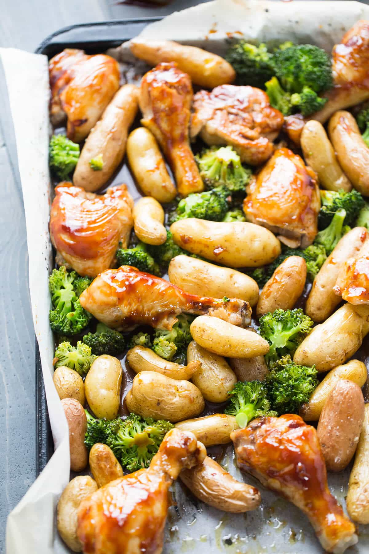 A sheet pan dinner is so easy! Bourbon Chicken is baked and tossed with potatoes and broccoli. The bourbon sauce is subtly sweet and coats each piece perfectly!