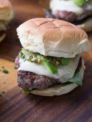 Pork burgers are a great change from the normal beef burger. These burgers have a simple Verde sauce on top!
