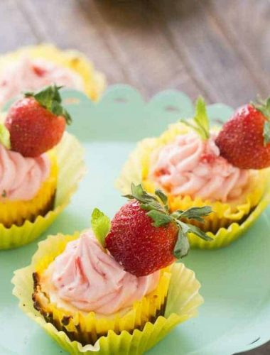 Strawberry lemonade cheesecakes will make you happy! They are sweet, tangy and totally delicious!