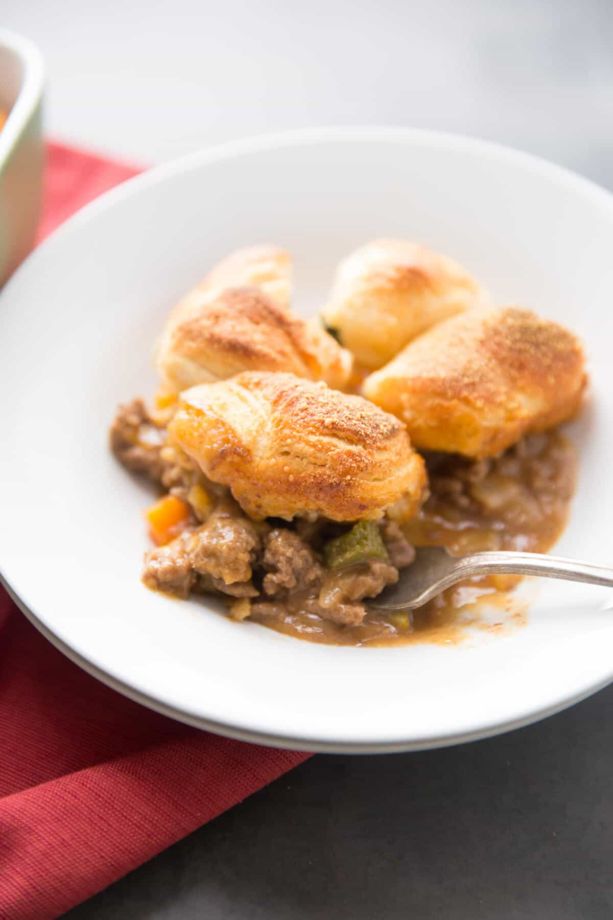 Cheeseburger pot pie is a simple, home cooked comfort food that will both please and nourish your family.